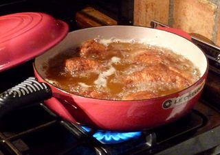 Frying the Chicken, Photo by Alexis Abel