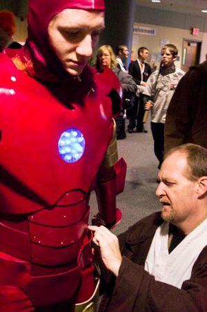 Clay Cardwell of Omaha helps his son Tamren, then 16, back into his Iron Man costume at the 2008 Anime NebrasKon convention in Lincoln. Photo: Hilary Stohs-Krause