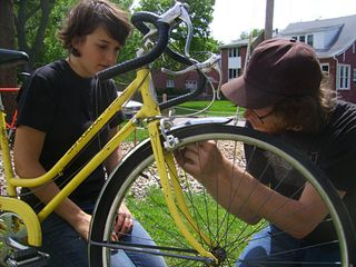 Lindsay Graef and Drew Nelson work at the Near South Community Bike Kitchen on a recent Sunday. Photo: Joe Younglove